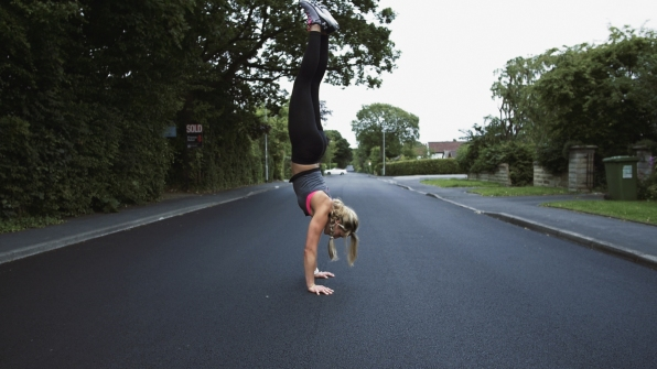 Fitness Girl Sports lady hand stand on street