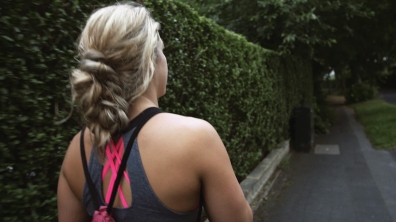 Fitness Girl Sports lady leaves home to go exercise on street