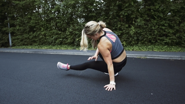 Fitness Girl Sports lady exercises on street