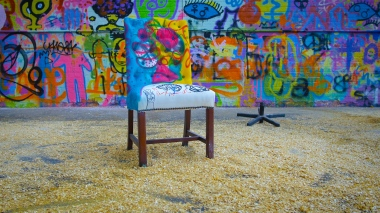 Colourful chair and graffiti at Sunny Bank Mills